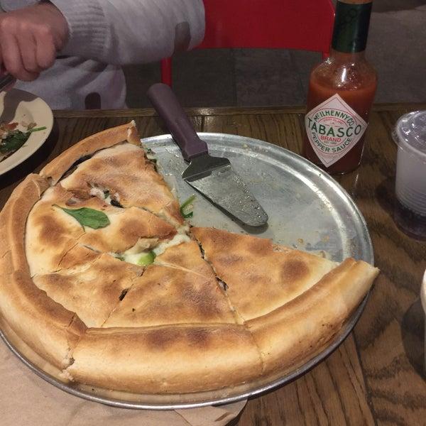 Photo taken at Regents Pizzeria by Emine E. on 1/5/2017