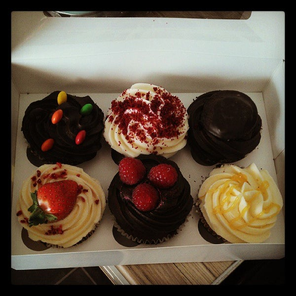 Photo taken at Cupcake Cafe by Graham C. on 6/2/2013