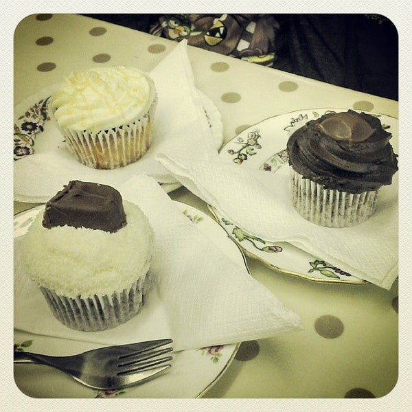 Photo taken at Cupcake Cafe by Graham C. on 10/12/2013