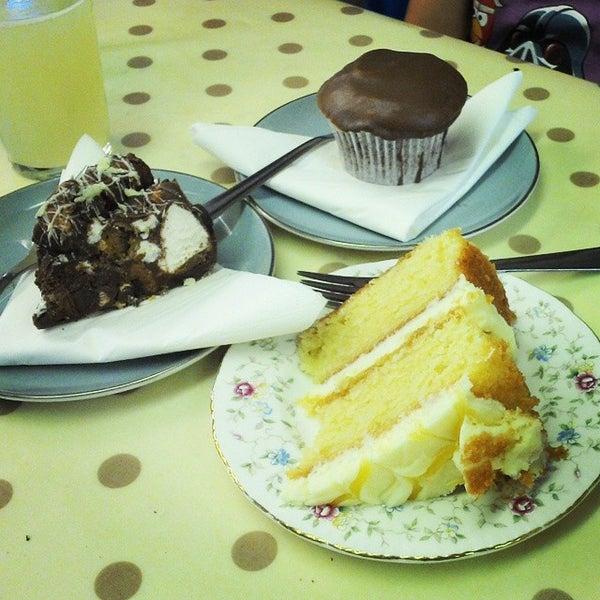 Photo taken at Cupcake Cafe by Graham C. on 8/9/2014