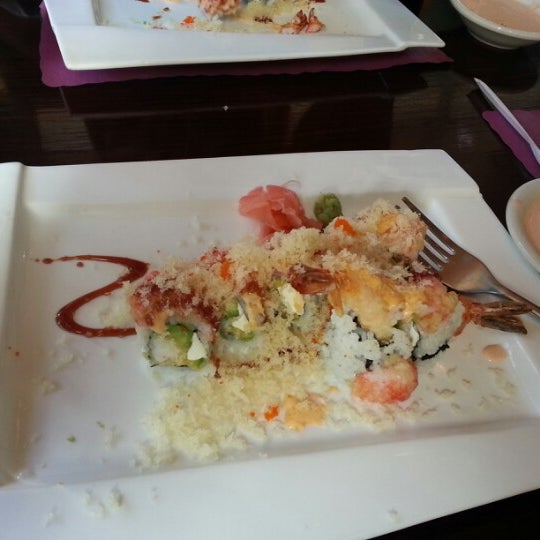 Photo taken at Sushi Cafe by Tristen C. on 12/2/2012