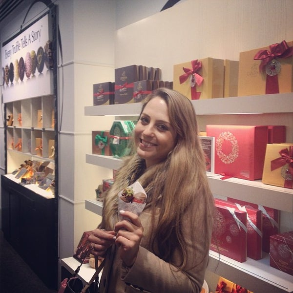 Photo taken at Godiva Chocolatier by Camila S. on 11/17/2013