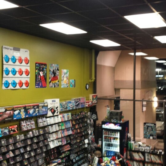 Photo taken at Game Over Videogames by Marcela A. on 12/28/2013
