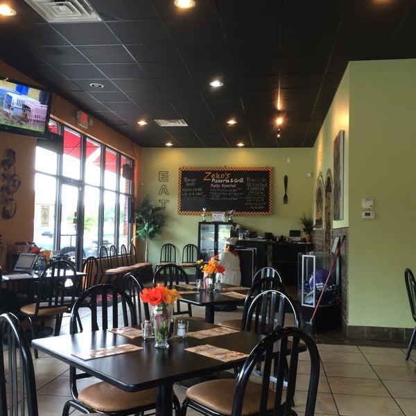Photo taken at Zeko's Pizzeria & Grill by Travis C. on 6/17/2016