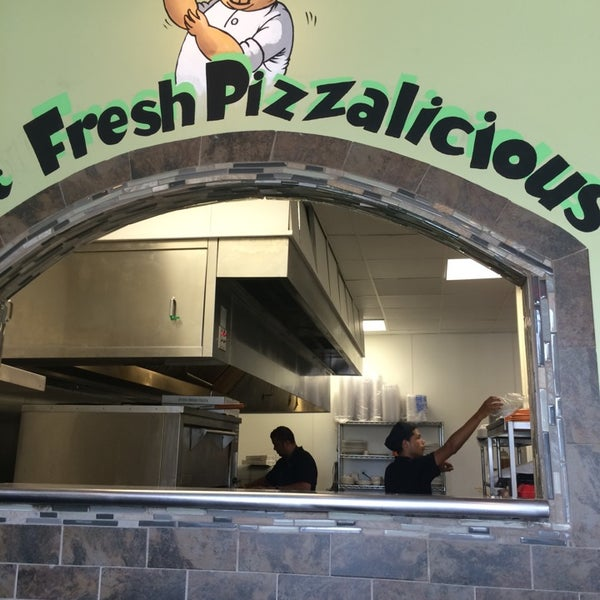 Photo taken at Zeko's Pizzeria & Grill by Travis C. on 6/4/2014