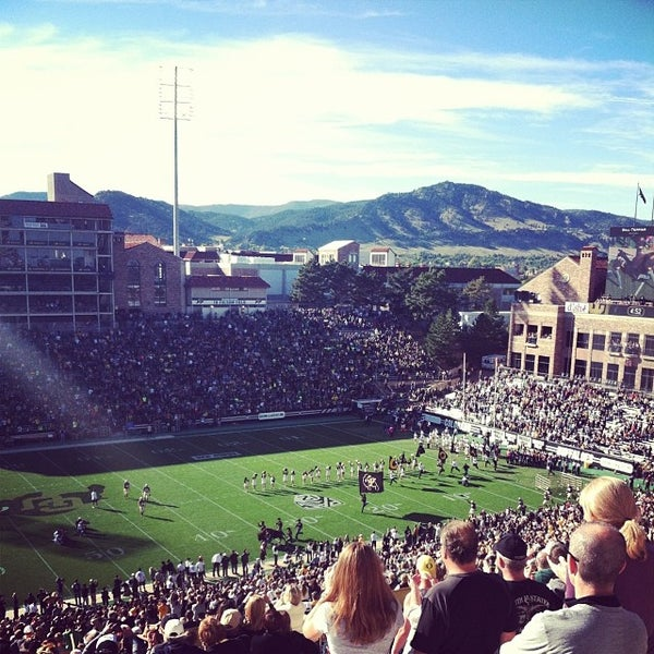 Photo taken at Folsom Field by Maggie T. on 10/6/2013