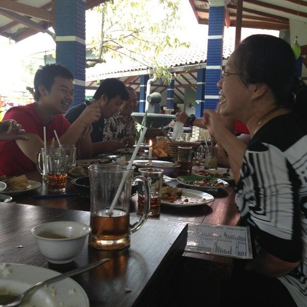 Photo taken at Ikan Bakar Bambu Haur by Agatha Vania S. on 2/10/2013
