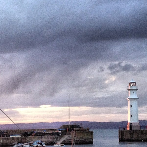 Photo taken at Newhaven Harbour by Alexander C. on 5/1/2013