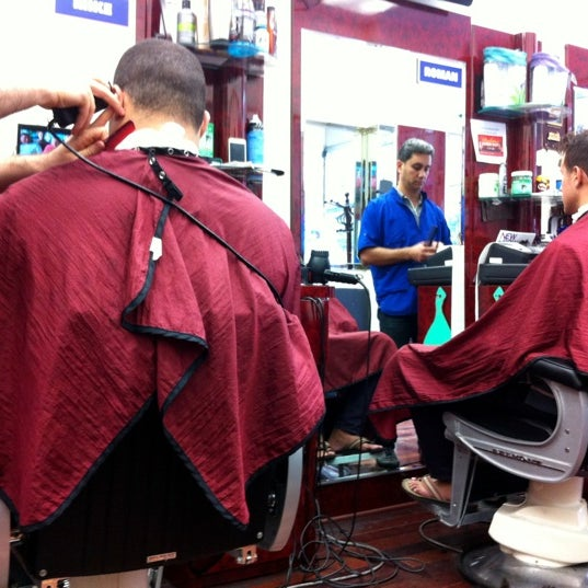 Photo taken at Manhattan Barber Shop by Tony C. on 9/14/2012