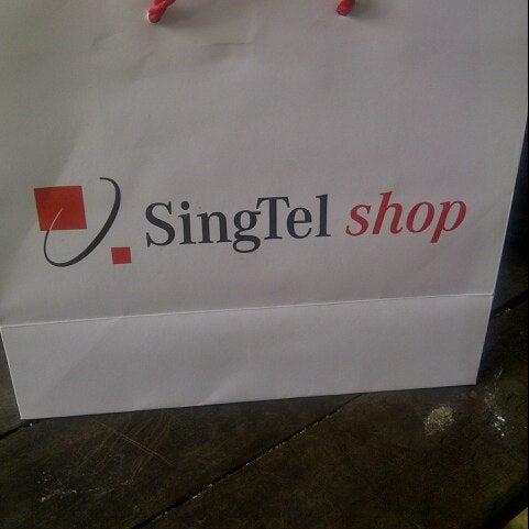 Photo taken at Singtel Shop by Gus V. on 8/22/2013