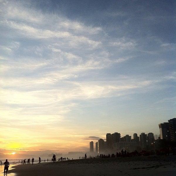 Photo taken at Praia da Barra da Tijuca by Leonardo K. on 3/16/2013