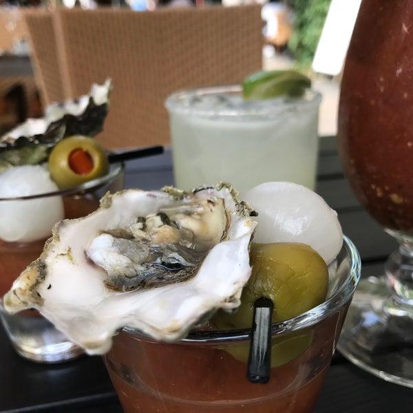 Photo taken at Village California Bistro & Wine Bar by Viet D. on 6/24/2017