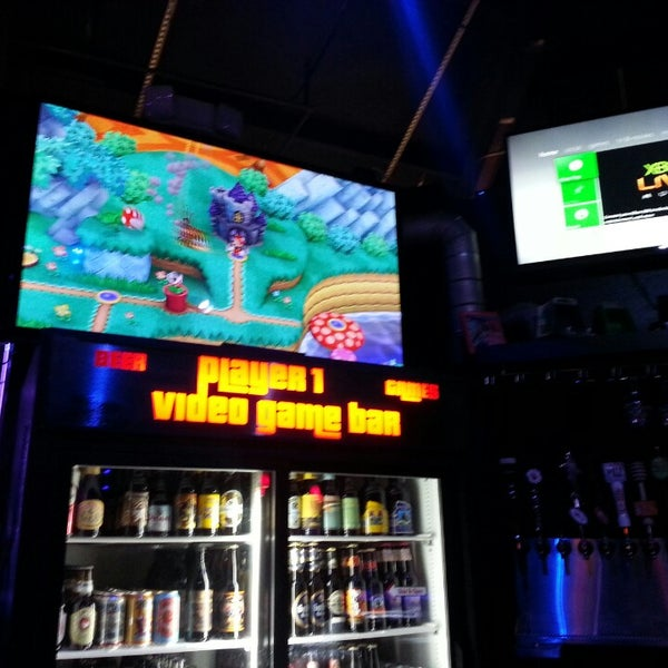 Photo taken at Player 1 Video Game Bar by Tanoodej A. on 5/22/2013
