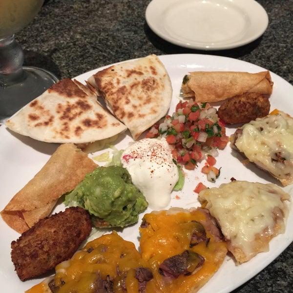 Photo taken at Mexi-Go Restaurant by Richard E R. on 6/14/2015