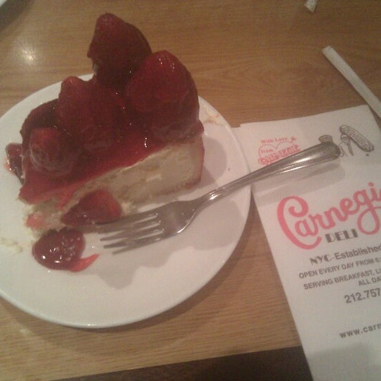Photo taken at Carnegie Deli by Eric H. on 12/18/2012