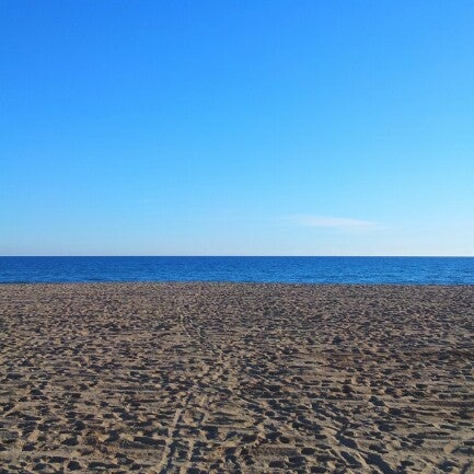 Photo taken at Platja de Calafell by Hernan G. on 1/2/2013