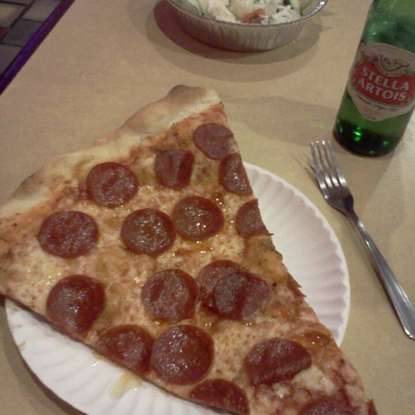 Photo taken at Burke Street Pizza by Michael P. on 4/7/2013