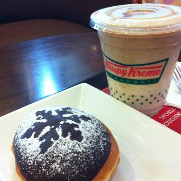Photo taken at Krispy Kreme by Diana Chriscille A. on 12/24/2012