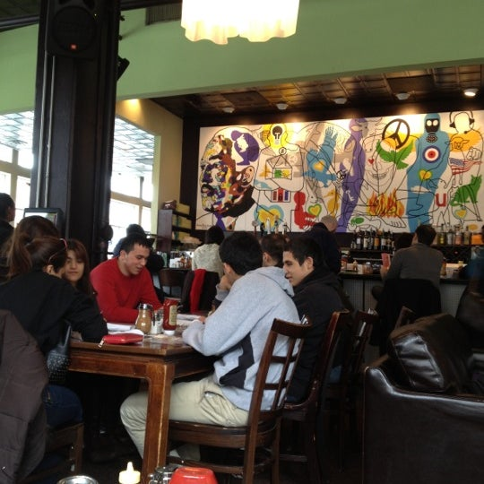 Photo taken at Busboys and Poets by Cindy Y. on 3/24/2013