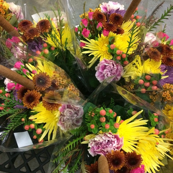 Photo taken at Market Flowers by Kelsey S. on 10/25/2014