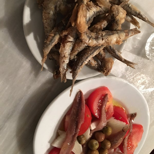 Fried fish and anchovies with tomatoes and onions. Although very simple and traditional.. these dishes are worth the visit. Promise.