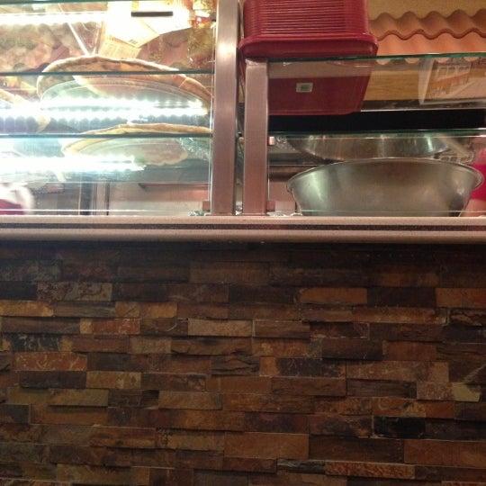 Photo taken at Romeo's Restaurant by Sean on 12/15/2012