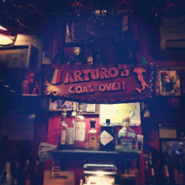 Photo taken at Arturo's Restaurant by Andy C. on 5/18/2013