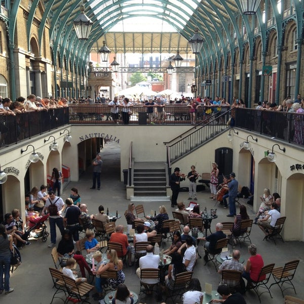 Photo taken at Covent Garden Market by Radik A. on 7/14/2013