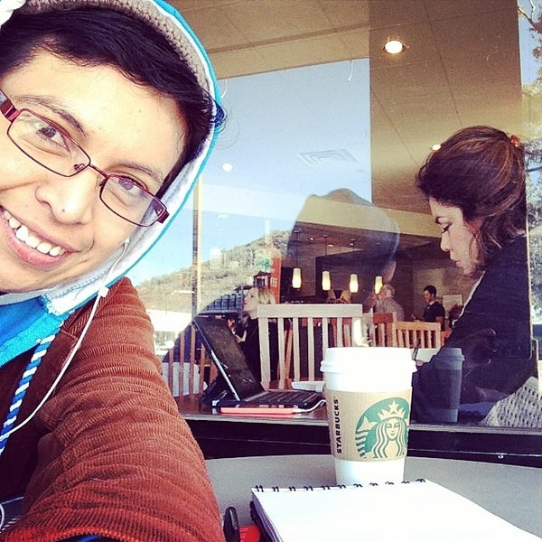 Photo taken at Starbucks by Denisse L. on 4/3/2014