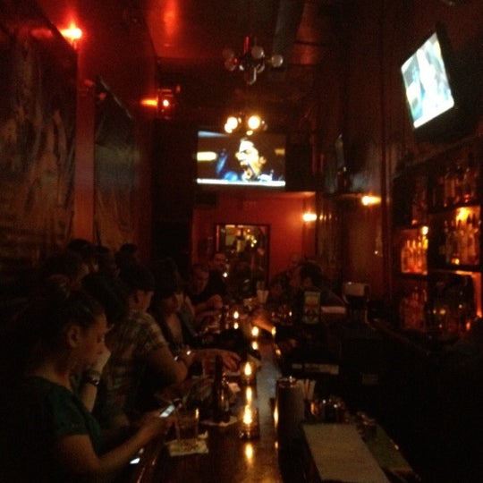 Photo taken at The SKINnY Bar & Lounge by Edie C. on 9/14/2012