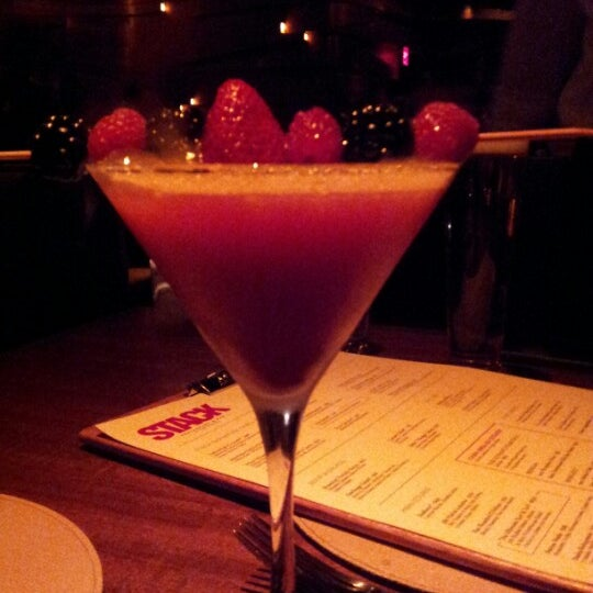 Photo taken at STACK Restaurant & Bar by Lindsay P. on 11/8/2012