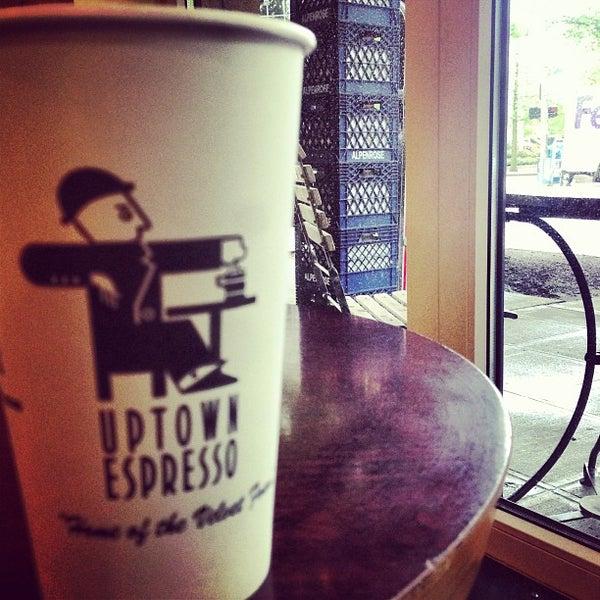 Photo taken at Uptown Espresso by Jascha K. on 5/21/2013