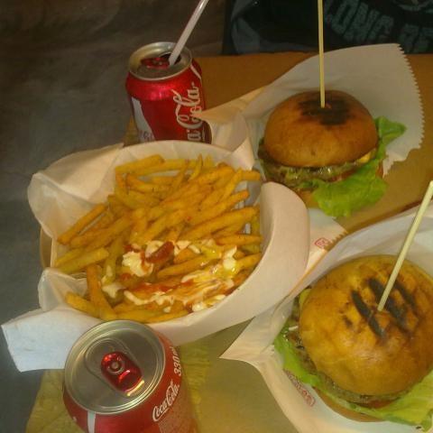 Photo taken at Biber Burger by Gülşah . on 12/2/2012