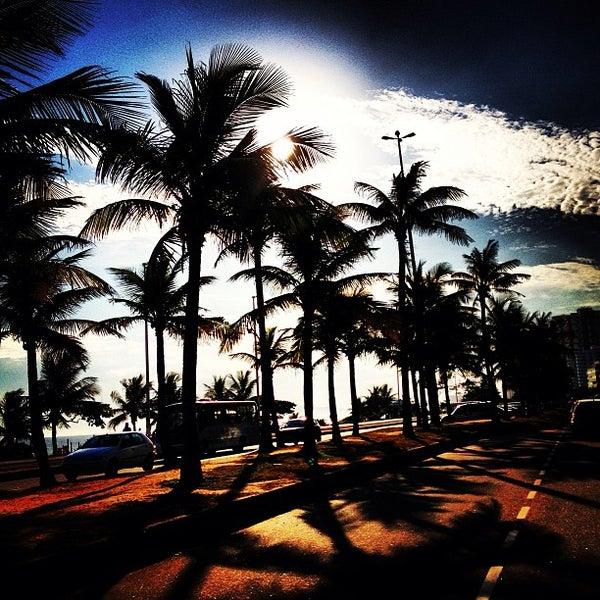 Photo taken at Praia da Barra da Tijuca by Beta B. on 2/18/2013