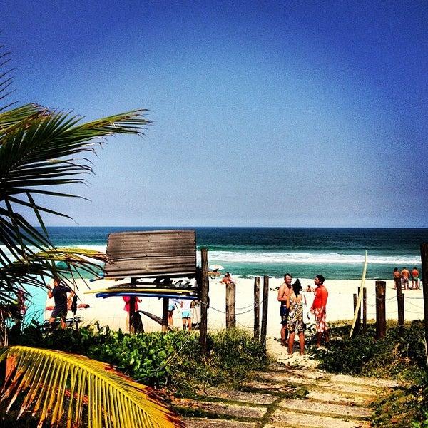 Photo taken at Praia da Barra da Tijuca by Beta B. on 4/28/2013