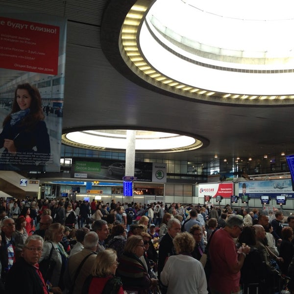 Photo taken at Check-in desk by Alexander O. on 8/24/2013