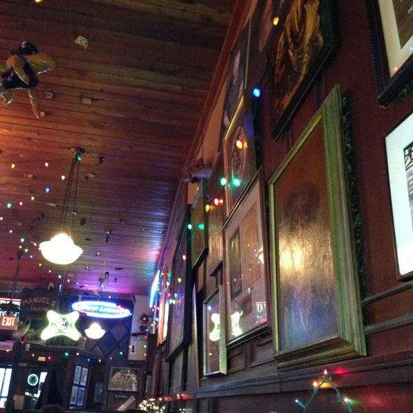 Photo taken at Manuel's Tavern by Karen K. on 12/23/2012