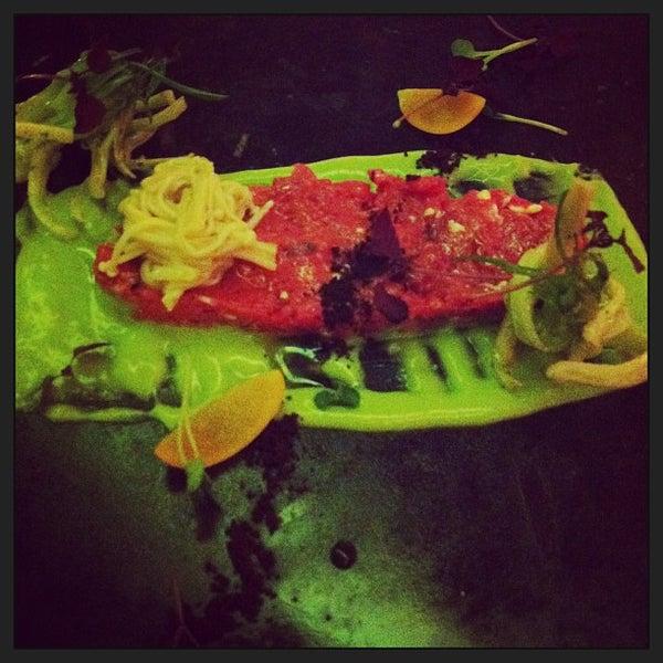 Photo taken at Imago Restaurant by Karen C. on 3/27/2013