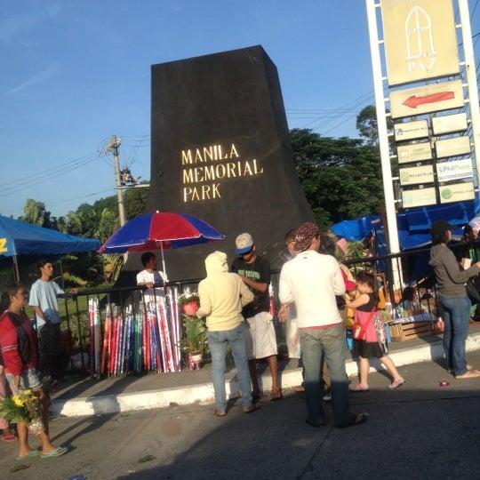 Photo taken at Manila Memorial Park by JM S. on 10/31/2012