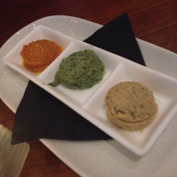 Photo taken at Glow Restaurant by Cynthia C. on 7/19/2014