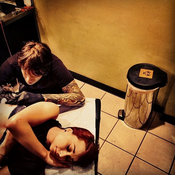 Photo taken at Let It Bleed Tattoo by MURDER P. on 4/2/2014
