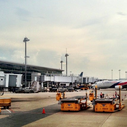 Photo taken at Tan Son Nhat International Airport (SGN) by Lawrence S. on 6/9/2013