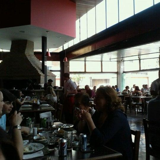 Photo taken at Bondbico Galeteria by Bruna L. on 10/21/2012
