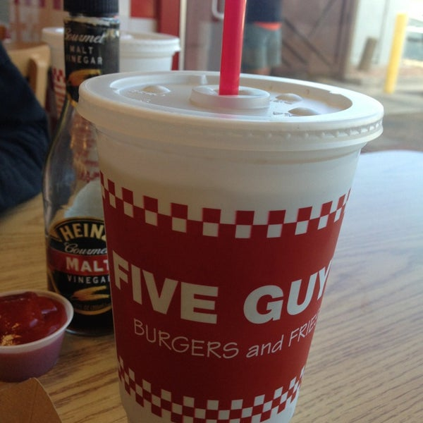 Photo taken at Five Guys by Craig M. on 12/31/2012