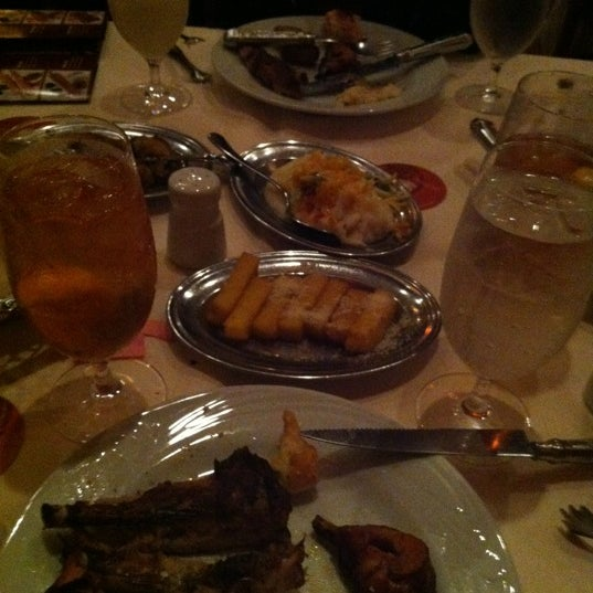 Photo taken at Fogo de Chao Brazilian Steakhouse by Johnny S. on 11/16/2012