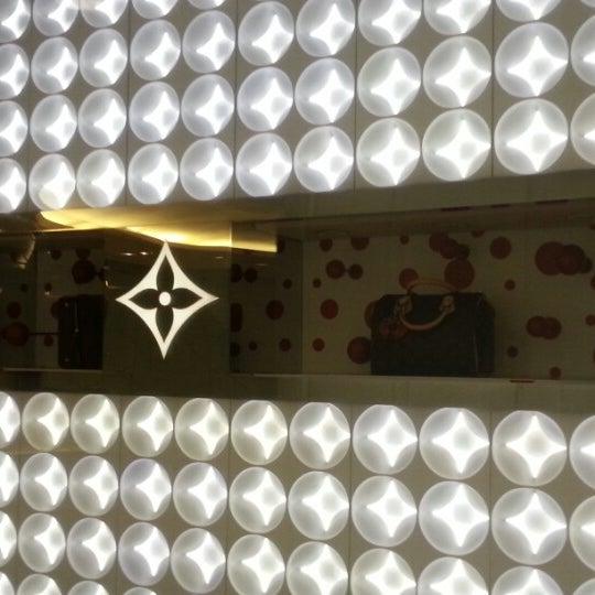 Photo taken at Louis Vuitton by Alan C. on 10/3/2012