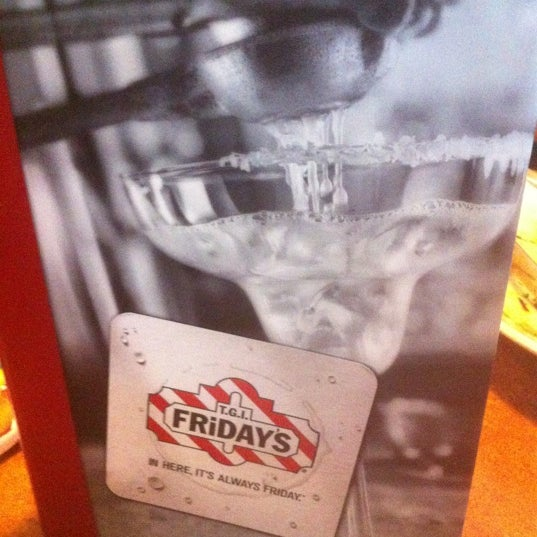 Photo taken at TGI Fridays by Sam A. on 10/14/2012