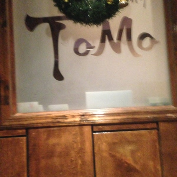 Photo taken at Tomo Japanese Cuisine by Stephanie P. on 1/29/2013