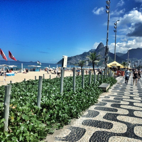 Photo taken at Ipanema Beach by George S. on 4/22/2013
