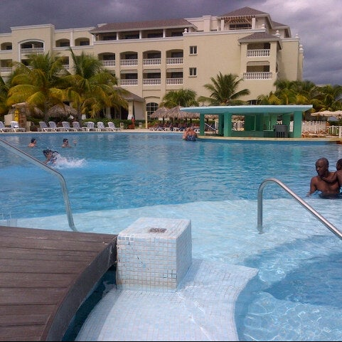 Photo taken at Iberostar Rose Hall Suites by Micole S. on 9/30/2012